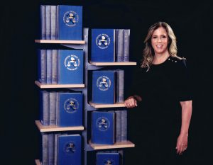 Rabbi Jessica Spitalnic Mates with the Blue Books from the Nuremberg Trials