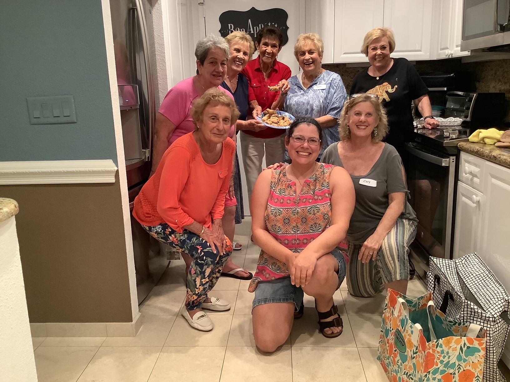Members of the Cooks' Corner Beth El Circle in a member's kitchen making rugelach cookies